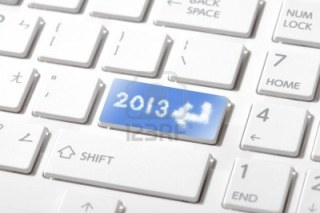 15254600-enter-2013-happy-new-year-computer-keyboard-close-up-concept-for-technology-or-cloud-computing